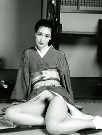Fantastical oriental female is posing undressed for a photoshoot